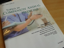 Topics in companion animals journal cover